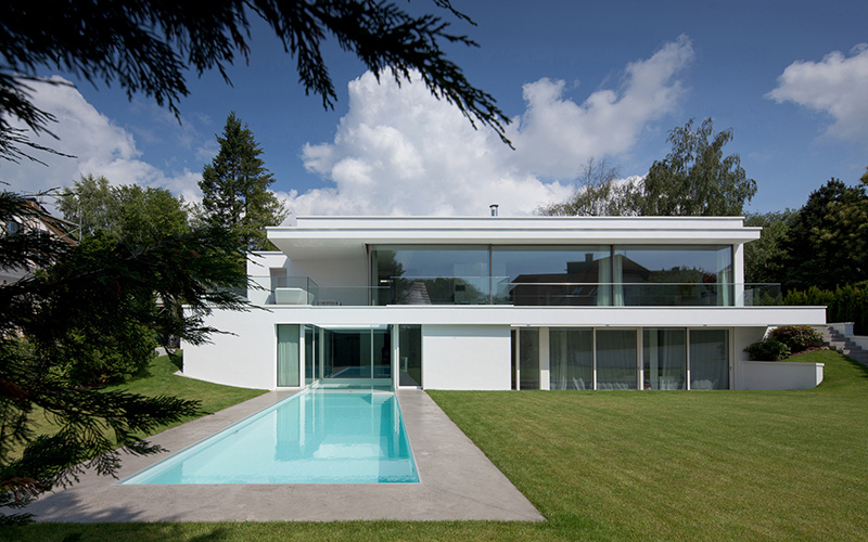 german-property - the picture shows a modern villa with pool near Frankfurt am Main, Germany